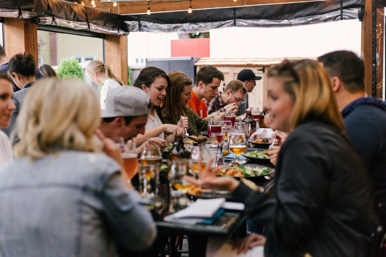 Large group eating outside during restaurant week in Marco Island