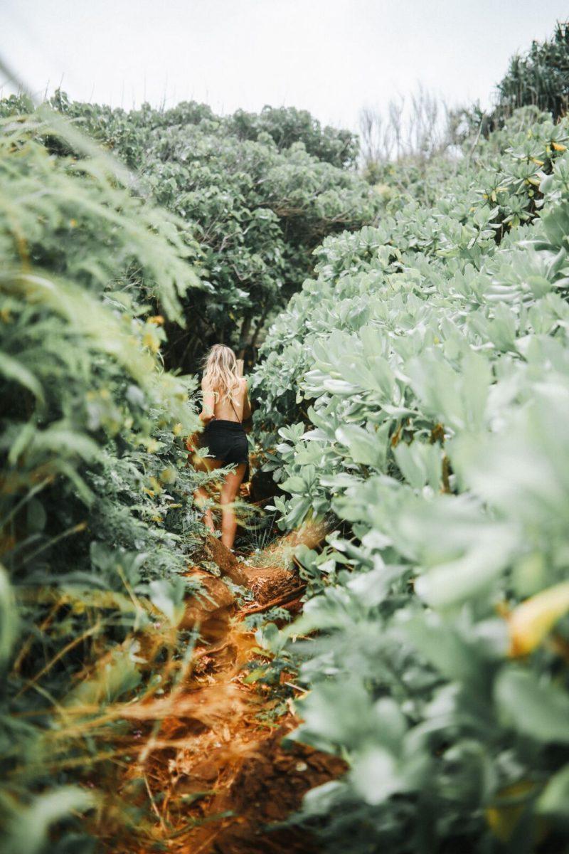 woman walking through brush