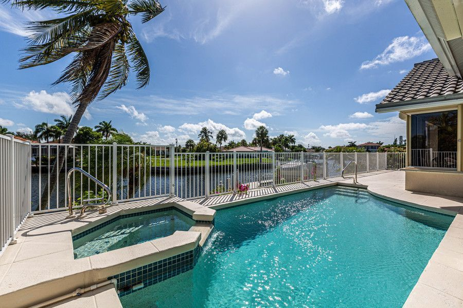 pool in a backyard of Marco Island rental