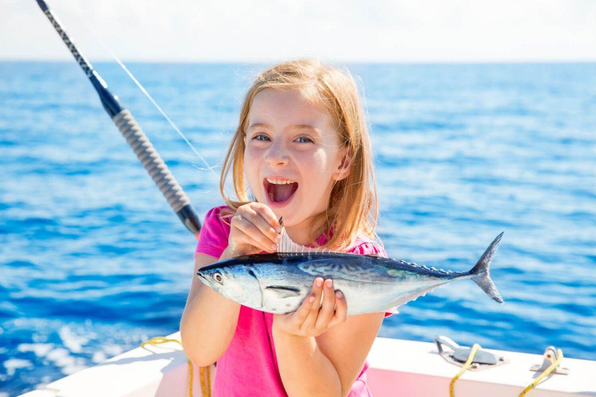 Picture of a girl enjoying a Marco Island fishing charter.